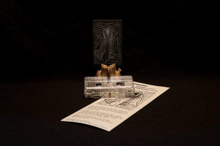 Silver ink on black cardboard & laser printed paper insert
