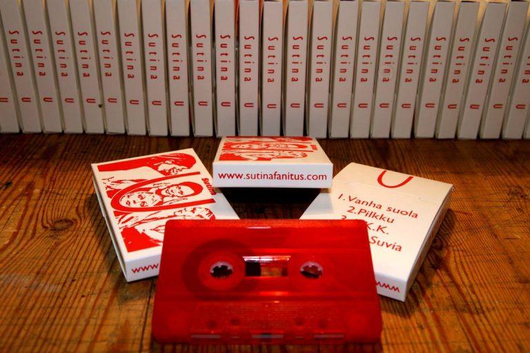Red ink on white semi-glossy cardboard