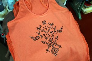 Black ink on Sol's Orange MOKA women's racer tank top